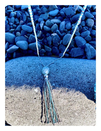 """Look at this gorgeous Boho piece just in! Here's the details  Color: Silver/Blue Beaded Detail Charm Detail Tassel Detail Stone Detail Stones May Vary 21"""" Drop 29.5"""" Chain Length  Composition: Iron Brass Stone"""
