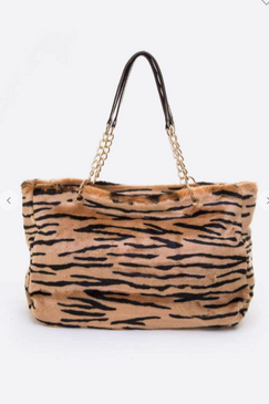 "Can you EVEN! Most likely you won't see this except for in the jungle! Tiger print tote bag from L.A. Check out our leopard tote too! chain strap detail!  Length - 18"" Width - 6"" Height -  10.5"" / 20.5"" With Handle Lead & Nickel Compliant"
