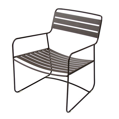 The Surprising low armchair shown in liquorice.