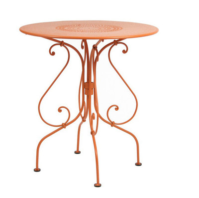 "The 1900 26"" pedestal table shown in Paprika."
