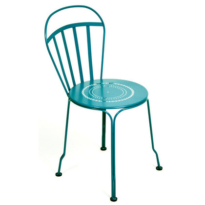 The Louvre side chair shown in turquoise.