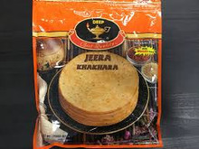 Crunchy, very thin wheat crisps tradionally eaten during breakfast.They are made with wheat flour,oil and salt. This variety is flavored with cumin seeds. Comes in a vaccum sealed pack with masala spice packet for  sprinkling on Khakhara.
