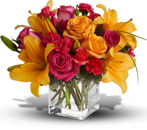 Uniquely beautiful and uniquely bright, this is a bona fide bombshell of a bouquet. Brilliant blossoms are perfectly arranged in an exclusive cube vase.
