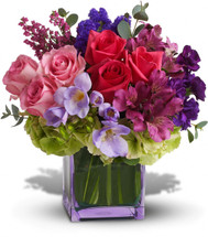 No other name could possibly describe this exquisitely beautiful bouquet. Its brilliant blossoms are gorgeously arranged and delivered in an exclusive lavender vase. Let her know how special she is to you by sending this fabulous gift.