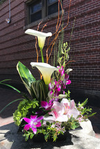 Our Ikebana style arrangement Simple and natural floral art using orchids, hydrangea and mini callas and tropical greenery. Very Zen!