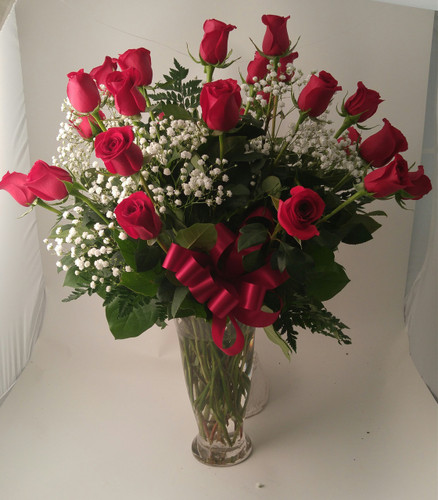 Two dozen spectacularly gorgeous red roses delivered in a dazzling flared glass vase - positive proof that love is a many-splendored thing. Imagine her loving this amazing bouquet day after day. Hero-worshipping time.  You can chose a different color just mention the color in special instructions.