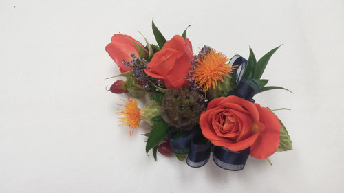 Beautiful Fall colors with spray roses, hypericum berries, safflower, scabiosia pods