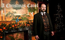 """Presented by Byers' Choice Carolers and FORTIN GAGE flowers and gifts.   Gerald Charles Dickens, the great great grandson of Charles Dickens, will appear in a one man show of """"A Christmas Carol"""" for the 10th year in a row.  If you haven't been to one of his shows you are missing out.   Tuesday, November 27th, 2018 at the Nashua Community College - Show begins at 7:00 pm.  General Admission seating tickets are $25.00. First come first severed section seating.   In the """"Spirit"""" of Charles Dickens' """"A Christmas Carol"""" we ask those attending to bring an unwrapped gift or gift card.  All gifts will be distributed to less fortunate children thru The Front Door Agency and The Salvation Army."""