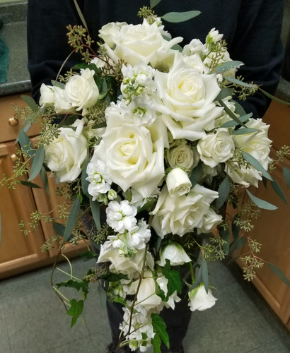 This elegant bridal bqt has a mix of roses, stock, ivy  and eucalyptus