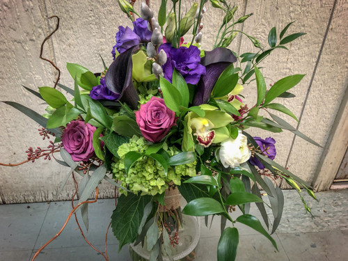 This Beautiful jewel tones bridal bqt is absolutely stunning with the mix of Callas, Roses, Hydrangea, Lisithus, Pussy Willow, Orchids, Eucalyptus wrapped in a Burlap ribbon.  The starting price for this Bqt is $150.00
