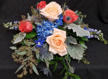 Mix of Roses, delphinine, dusty miller, thistle and eucalyptus