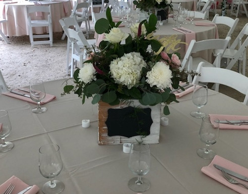 Perfect for your Rustic wedding, This wooden box centerpiece filled with beautiful white hydrangea, roses, cremons and eucalyptus