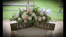 (SIGNS NOT INCLUDED)  This sweet & elegant sweetheart table filled with hydrangea, roses, eucalyptus