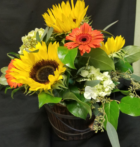 Sunflowers, Gerber Daisy's Hydrangea and eucalyptus in a rustic bucket