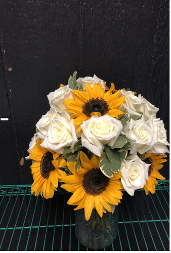 This bright and Beautiful Bridal Bouquet has a nice mix of white roses and sunflowers.  Starting point for this bqt is $125.00