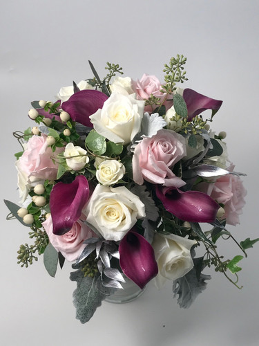 Mix of Roses, Callas, Dusty Miller, Eucalyptus, Silver Ruscus, Hypericum & Ivy