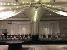 This stunning backdrop can be set up behind the bridal party at your venue!