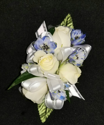 White roses with blue delphinium accents