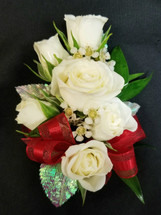 White spray roses with a red ribbon