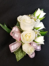 White spray roses with light pink ribbon