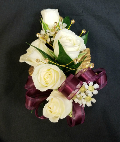 White Spray roses with a wine ribbon and gold gem accents