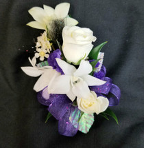 Mix of white spray roses & white dendrobium orchids with a purple ribbon