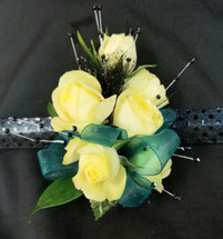 Pale yellow roses with teal ribbon and an upgraded snap band with accenting black pearl sprays