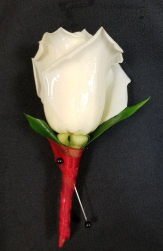 White rose with a red ribbon wrapped stem