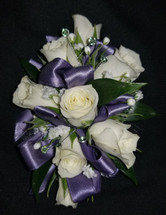 White roses with a periwinkle ribbon and added accents of crystal gems