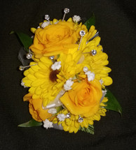 Yellow roses & daisy poms with pops of baby's breath and added crystal accents