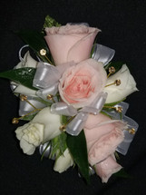 Pink and white roses with a white ribbon and added accenting gold gem