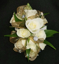 White roses with gold ribbon and 6 large rhinestone gems added for that WOW factor