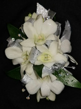 White dendrobium orchids with a silver ribbon and added crystal gems