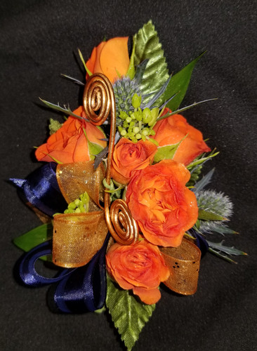 Orange roses with a copper and navy blue ribbon with added copper wire to give this corsage added detail