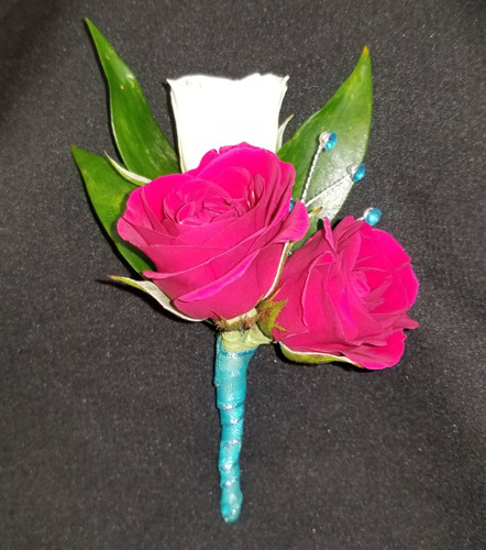 White and hot pink mini roses with a teal ribbon wrapped stem and added turquoise gems