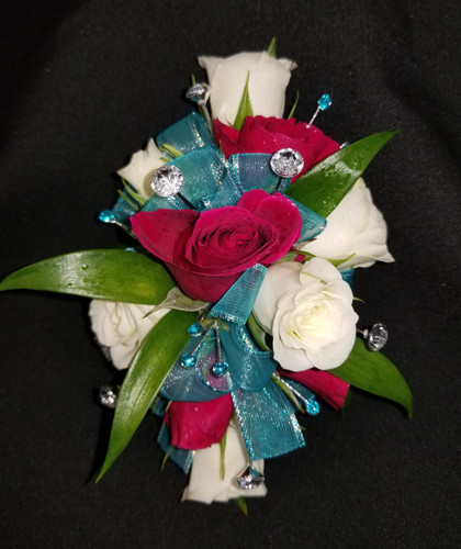 White and hot pink roses with a teal ribbon, turquoise gems and 6 added large rhinestones