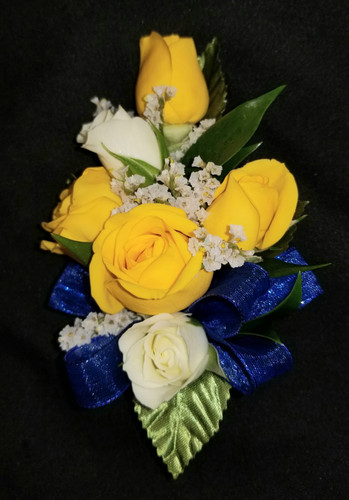 White and yellow roses with a royal blue ribbon