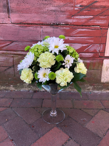 Perfect for your favorite Irish Friend! Mix of green and white flowers with a pot of gold on the inside of the glass!