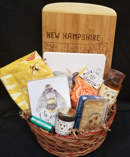 """Savannah  Bee Honey Co out of Georgia  This basket is perfect for any honey lover! Comes with lip balm, raw honey comb, whipped honey, honey bee socks, 12oz jar of honey, """"oh honey"""" sign, Bee Happy kitchen towel, bee notebook and a NH bamboo cutting board  Perfect gift for a Birthday, Graduation, Just because!"""