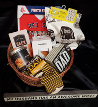Perfect for Father's day or Just any day to celebrate the special man in your life!  This basket includes Awesome DAD socks, Red socks photo frame, kitchen towel, World's greatest dad sign & LOL skinny sign, Bourbon candle, Whiskey Wedge, & A Beer Snob book