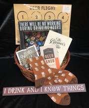 Perfect for Father's day or Just any day to celebrate the special man in your life!  This basket includes Beer socks, LOL skinny sign, Bottom's up coasters, PBK sign for Beer bottle caps, Beer snob book, Brew Tale book & A Beer Flight tasting mat!