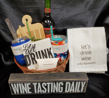 This is a great gift basket, Includes a wine sign ( saying may vary- wine related), bar towel, cheese board, 2 swig wine cups, choice of white or red wine, napkins and caramels