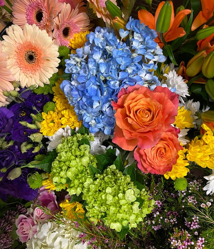 Let one of our very talented designers create a unique table size arrangement, sure to make mom smile.  Let us know if you'd like something in soft pastels or bright and springy - We'll do the rest!