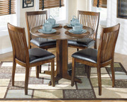 Ashley Stuman Medium Brown 5 Pc. Round Drop Leaf Table & 4 Upholstered Side Chairs