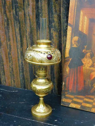 ANTIQUE REPOUSSE BRASS OIL LAMP IN THE ART NOUVEAU MANNER