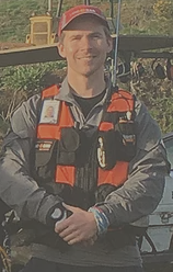 An Auckland Land search & Rescue team member with his Sleeves down in late winter early spring