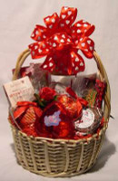 Here is our large Valentine Gourmet Basket.  We start out with a delicious bread dip mix and crispy crackers.  Then we add a microwaveable Popcorn Cob, a fruit and nut mix, luscious cookies, Earle Grey tea, and a small Valentine Plush.  Next comes luscious Valentine chocolates.  Then we add beautiful everlasting flowers and hearts.  What a wonderful way to celebrate the occasion!