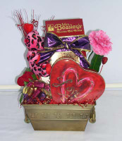 A beautiful keepsake container, laden with truffles and peanut butter cups in special  little bags and boxes, delectable cookies and a special Valentine plush.  A gift that's sure to have your recipient feel special.