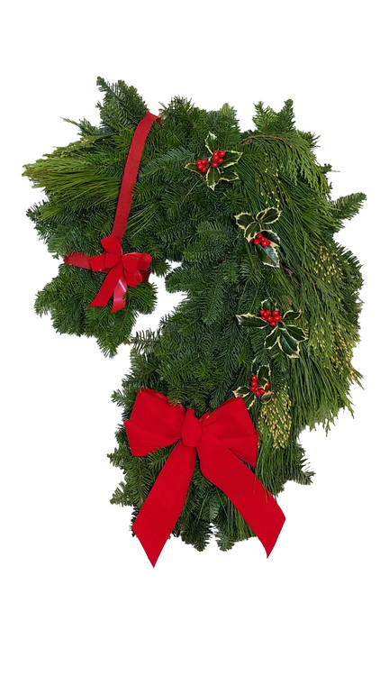 Handmade from our own natural noble fir, cedar, pine and holly, our holiday horse wreath is as fresh as your horse on a cold winter morning.                                         (Left facing wreath shown)