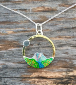 "John Muir's quote, ""The Mountains are calling and I must go"", resonates with all of us, and this mountain  necklace will too. It is is a tribute to the beauty and sanctity of our earth's mountains. I have fabricated it out of brass and Sterling, and hand-colored it, protecting it with 3 clear-coats, the final one being a tough resin. Metal components are lacquered. It measures a generous 3/4"" in diameter and is light to wear. It hangs from an 18"" Sterling silver chain."